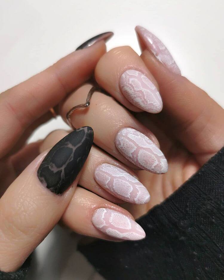 nude and black snake print nail trend